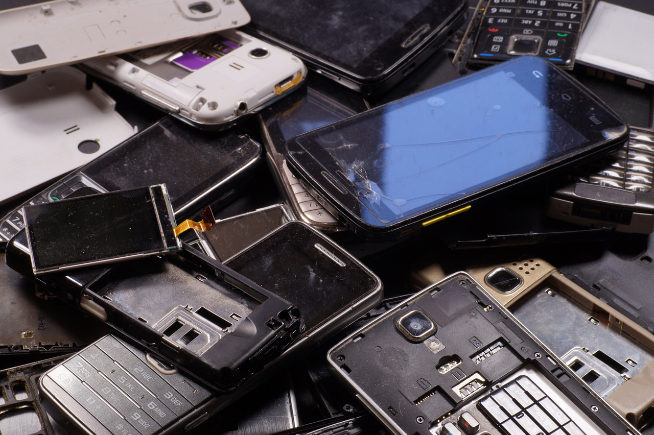 Electronic scrap. Different phones and smartphones not suitable for repair.